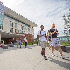 Students outside UMass Boston's University Hall