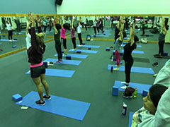 People stretching in a group fitness class